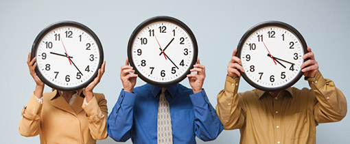 Row of people with clocks over their faces