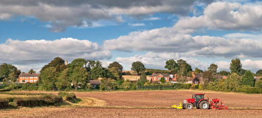 tractor at work near rural village