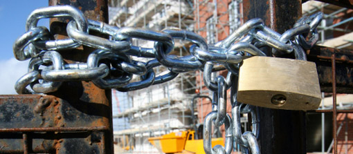 padlocked building site