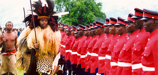 King Mswati III reviews his soldiers.