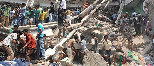 People search for survivors after the Rana Plaza building disaster in Bangladesh