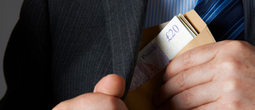 Businessman with cash in envelope