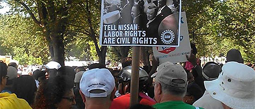 UAW marchers carrying Nissan placard. Photo: International UAW