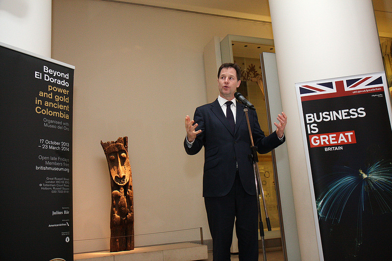 """Nick Clegg speaking front of a British Mueseum exhibition sign rerading """"Power and gold in Colombia"""""""