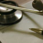 Doctor's stethoscope and pen