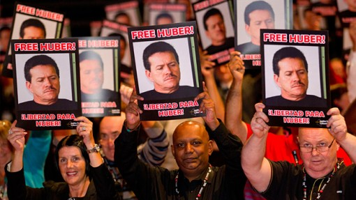 TUC 2013 delegates hold photos of Huber. Photo Jess Hurd, report-digital.co.uk