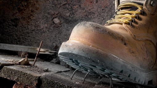 safety boots stepping on a nail
