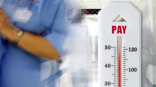 Blurred photo of a hospital ward with a thermometer with 'pay' written on it