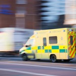 Photo of an ambulance driving on a road