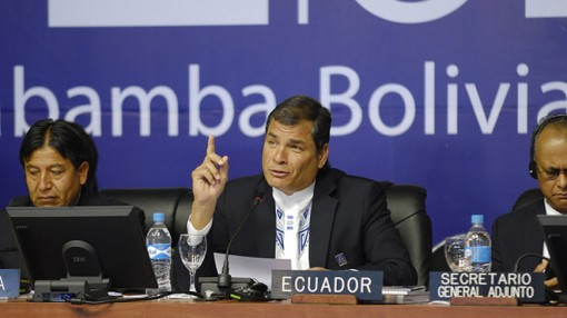 Correa, at the Organisation of American States' General Assemly, raising his finger as he speaks