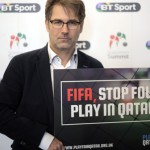 Jaimie Fuller, SKINS' Chair, holds a Playfair Qatar sign at the FSF Supporters' Summit