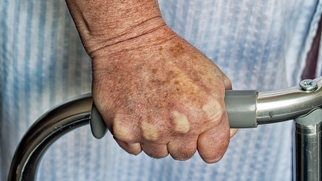 Hospital patient with walking frame
