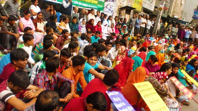 Bangladesh trade union members protest after the death of 112 colleagues in 2012