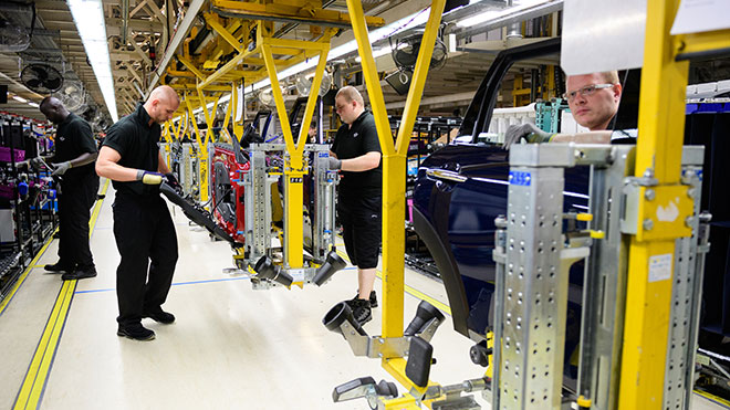 Workers assembling Mini cars in the Oxford BMW works.